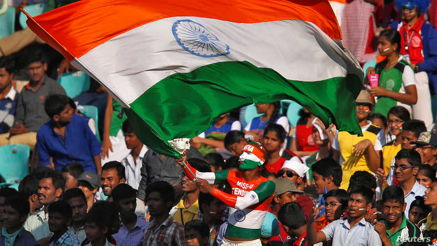 FILE - A fan waves an Indian flag during a cricket match against England, Nov. 19 ,2016.
