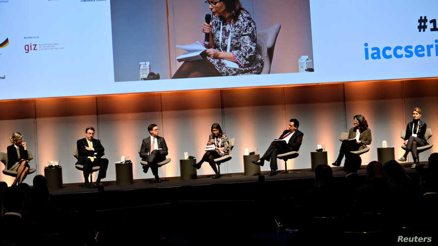 Development officials participate in the opening debate at the International Anti-Corruption Conference at the Bella Centre in Copenhagen, Denmark, Oct. 22, 2018.