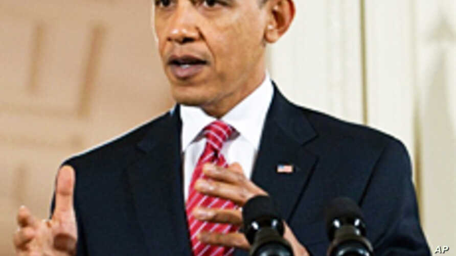 President Barack Obama speaks during a joint press conference with Indian PM Manmohan Singh (not pictured) at the White House, 24 Nov 2009