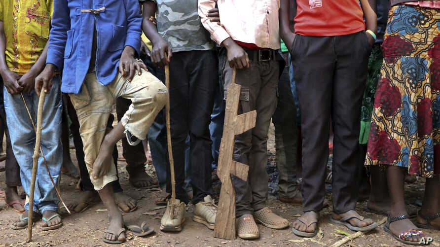 Former child soldiers stand in line waiting to be registered with UNICEF to receive a release package, in Yambio, South Sudan Wednesday, Feb. 7, 2018.