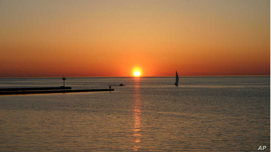 FILE - A sunset is shown on Lake Ontario in Niagara County.