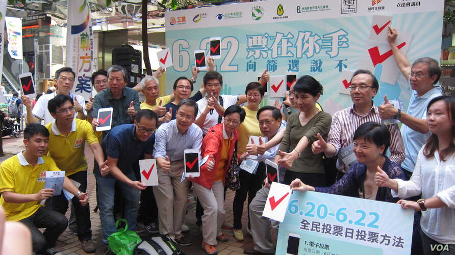 Pro-democracy lawmakers and activists gather in Hong Kong island's Causeway Bay shopping district to promote plans for an unofficial referendum on democratic reform, May 25, 2014.