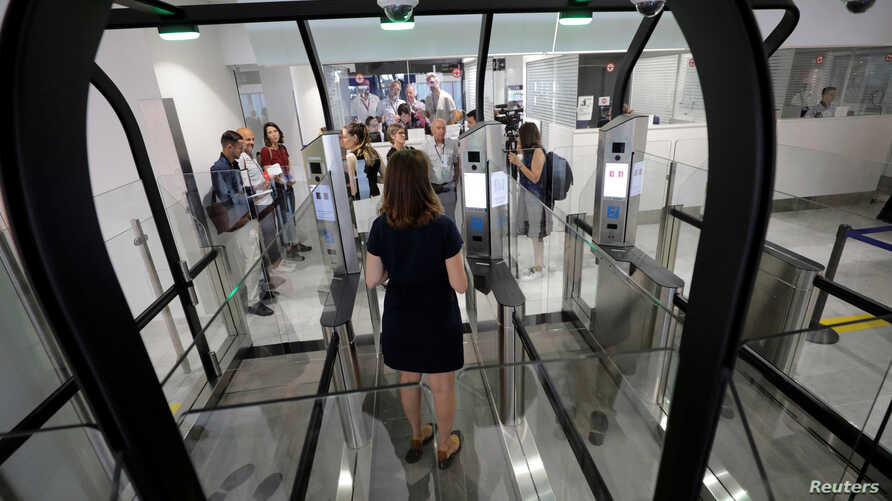 A passenger enters an airlock for facial recognition at Nice international airport's immigration section in Nice, France, July 16, 2018.