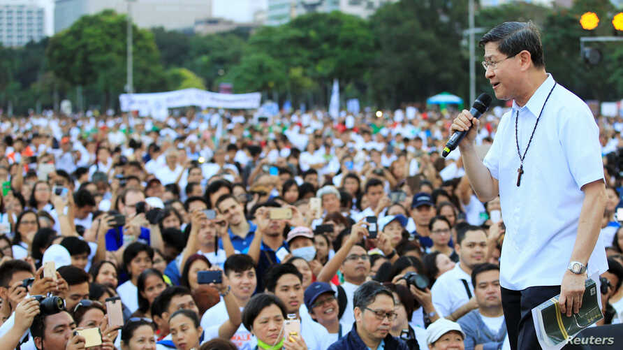 """Archbishop of Manila, Luis Antonio Tagle, delivers a message to the participants of the procession against plans to reimpose death penalty, promote contraceptives and intensify drug war during """"Walk for Life"""" in Manila, Philippines, Feb. 18, 2017."""