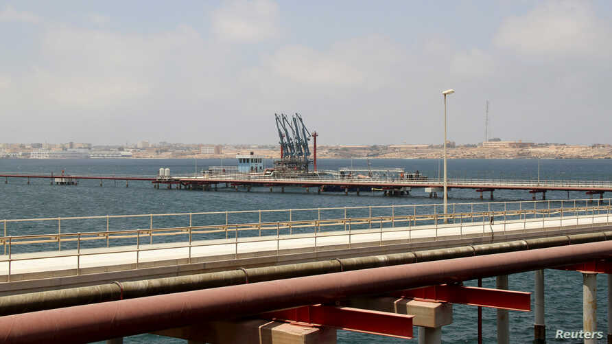 FILE - A general view of Libya's Hariga port in Tobruk, east of Benghazi, June 28, 2014.