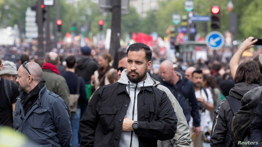 Alexandre Benalla, French presidential aide, is seen during the May Day labour union rally in Paris, France May 1, 2018. Picture taken May 1, 2018.  At L, Vincent Crase, employee of LREM. REUTERS/Philippe Wojazer - RC1C87DAB7B0