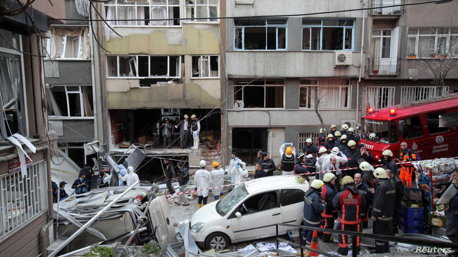 Forensic officers and firefighters work at the scene of a gas blast in Istanbul, Turkey, Feb. 17, 2014.