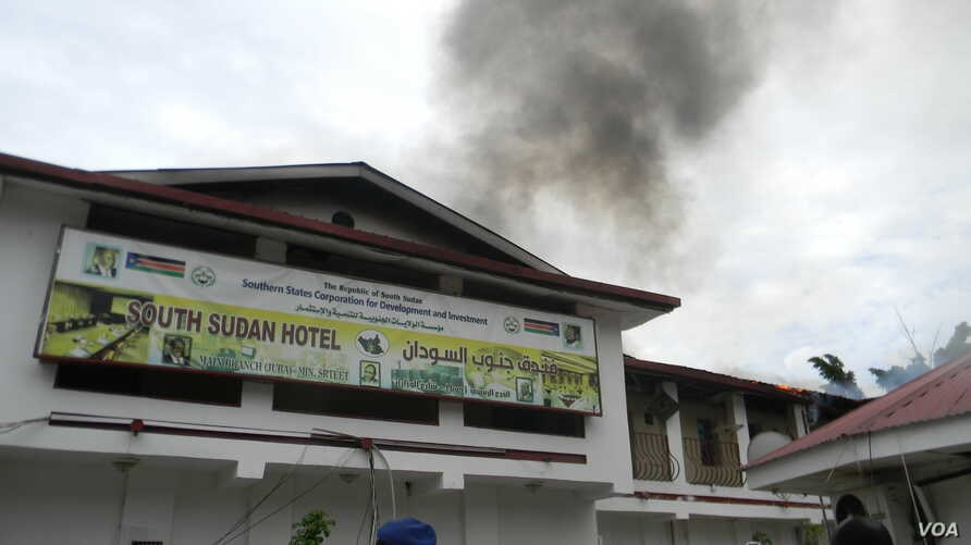 Smoke billows from the South Sudan Hotel in Juba and flames are visible under the roof after fire raked through the hotel on Wednesday, Oct. 2.