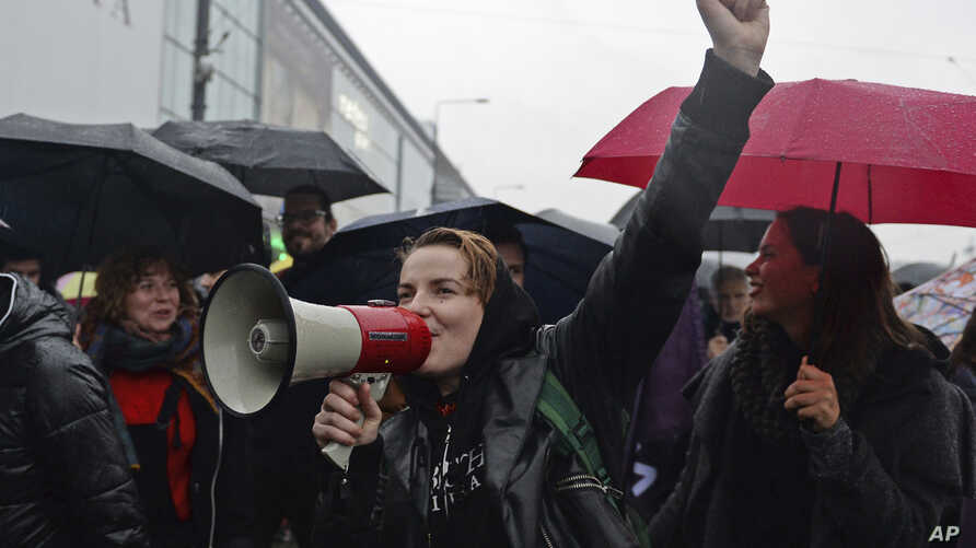 Women shout slogans as they march through the downtown in a protest against efforts by the nation's conservative leaders to tighten Poland's already restrictive abortion law, in Warsaw, Poland, Oct. 3, 2017.