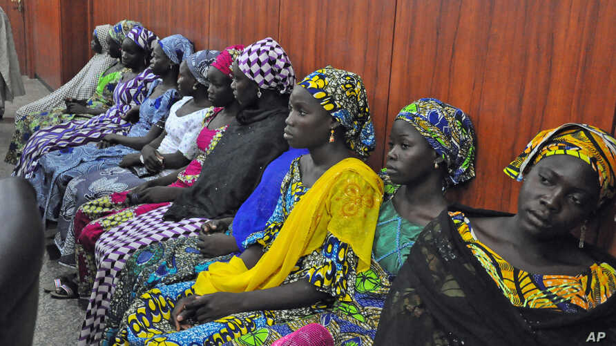 Some of the escaped kidnapped girls of the government secondary school Chibok, attend a meeting with Borno state governor, Kashim Shettima, in Maiduguri, Nigeria, June 2, 2014.
