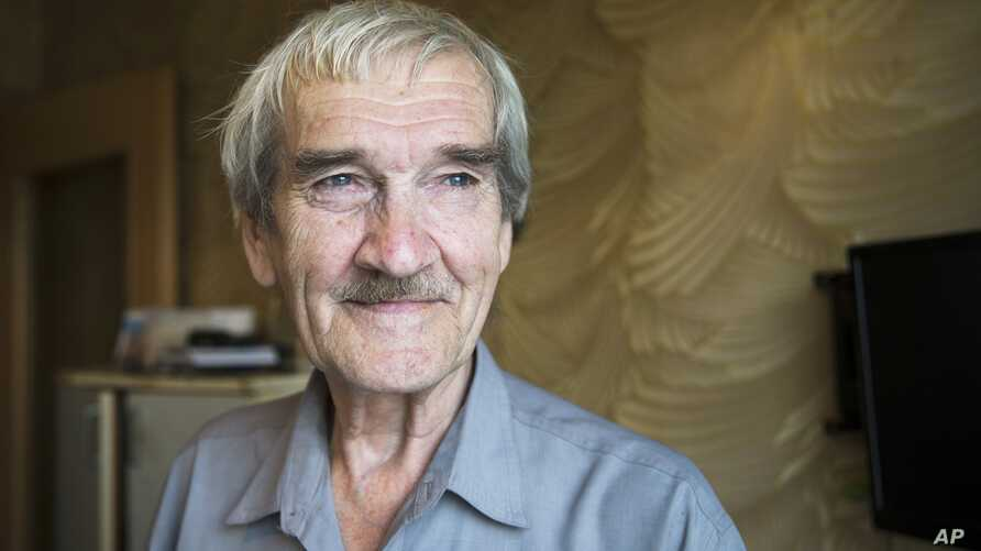 "FILE - Former Soviet missile defense forces officer Stanislav Petrov poses for a photo at his home in Fryazino, Moscow region, Russia, Aug. 27, 2015. Petrov, a former Soviet military officer known in the West as ""The man who saved the world'' for his"