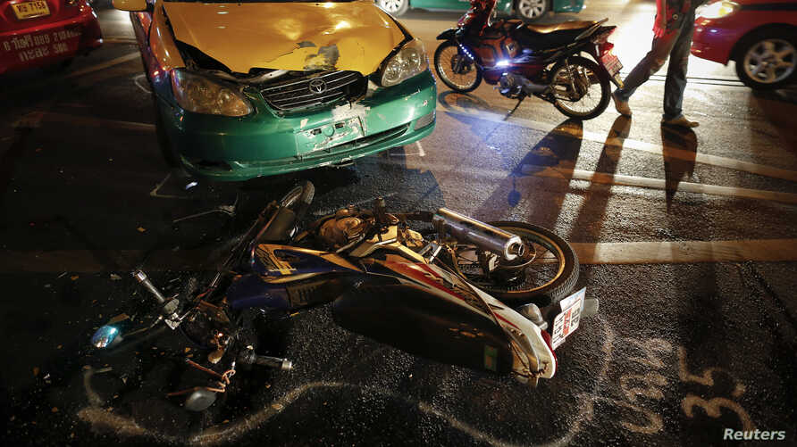 FILE - The positions of colliding vehicles are marked at the site of a road accident during the Songkran festival in Bangkok, Thailand.