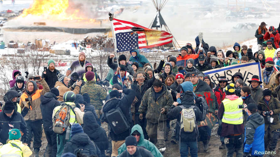 Opponents of the Dakota Access oil pipeline march out of their main camp near Cannon Ball, North Dakota, U.S., February 22, 2017.