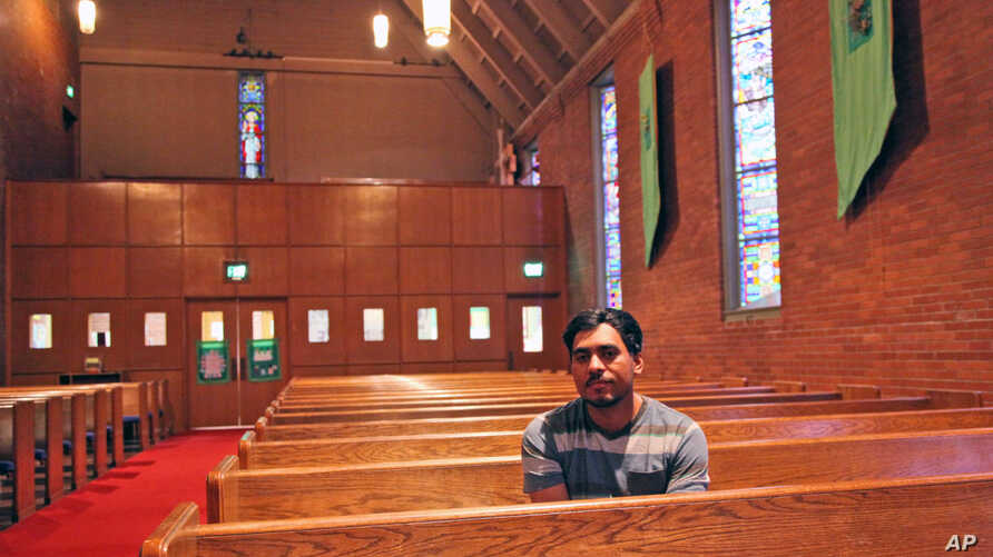 FILE - Francisco Aguirre Velasquez poses at Augustana Lutheran Church in Portland, Ore. Aguirre, an immigrant, took refuge at the church to avoid deportation. Photo taken July 6, 2015.