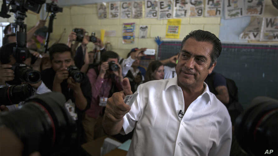 """Jaime Rodriguez, known as """"El Bronco,"""" an independent candidate for governor of the northern state of Nuevo Leon, shows his inked finger after casting his vote in Villa de Garcia, Mexico, Sunday, June 7, 2015."""