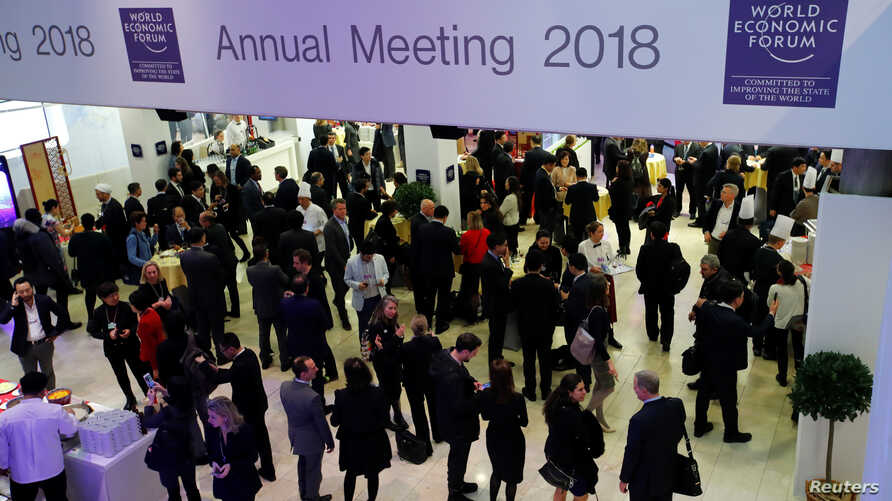 Attendees are seen during the World Economic Forum annual meeting in Davos, Switzerland, Jan. 24, 2018.