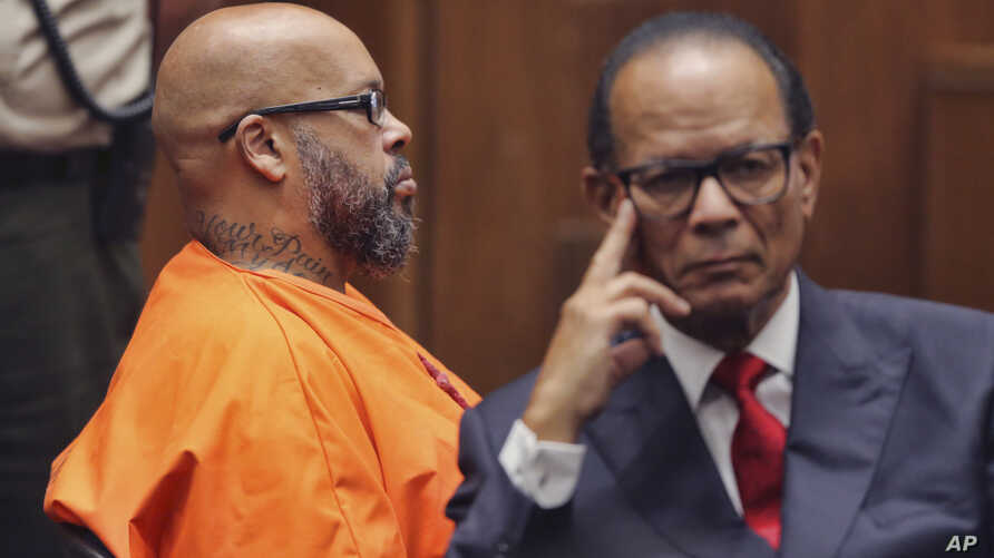 """Marion """"Suge"""" Knight, left, and his defense attorney, Albert DeBlanc Jr., appear in court in Los Angeles, Oct. 4, 2018. A judge sentenced him to 28 years in prison for the 2015 death of man he ran over outside a Compton burger stand."""