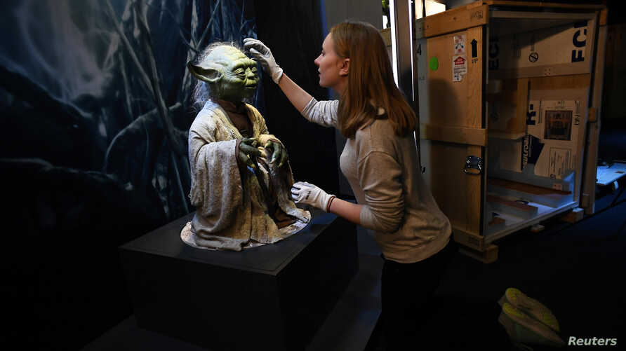 "Nicole Manis, of the Lucas Museum of Narrative Art, unpacks a Yoda puppet, November 8, 2016, used in the sci-fi movies. The ""Star Wars Identities"" exhibition begins next week in London."