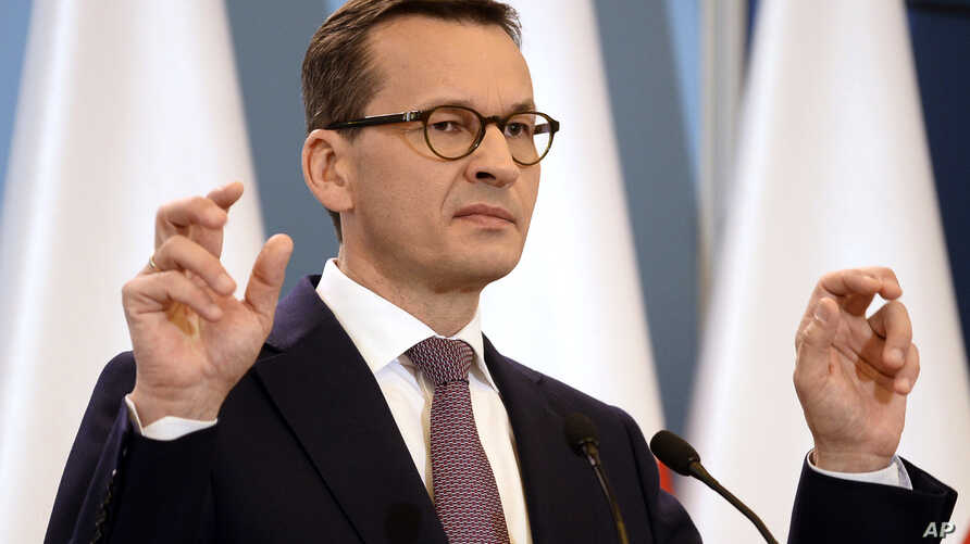 Polish Prime Minister Mateusz Morawiecki presents the joint declaration of the prime ministers of Israel and Poland, in his chancellery in Warsaw, June 27, 2018. Poland's President Andrzej Duda has signed into law amendments that abolish the threat o
