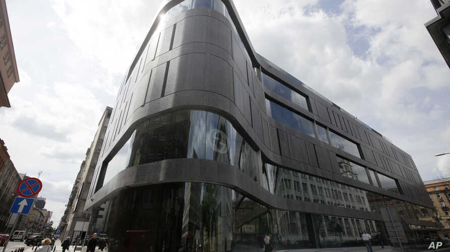 One of the latest additions to Poland's growing luxury goods market, the Wolf Bracka department store, beckons shoppers in the heart of the Polish capital, in Warsaw, May 31, 2012.