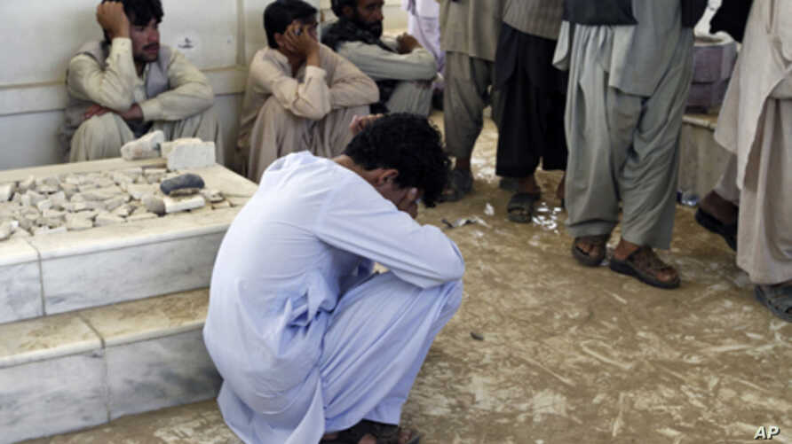 An Afghan mourns during the burial ceremony for Ahmad Wali Karzai, President Hamid Karzai's brother who was killed by a bodyguard on Tuesday, in Kandahar province July 13, 2011.