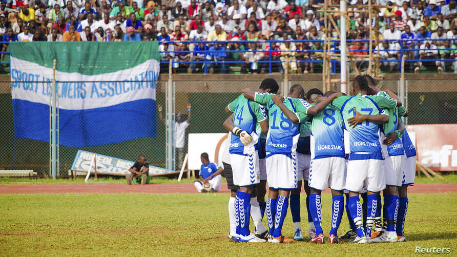 FILE - Sierra Leonean players huddle at their match against Niger at the national stadium, Freetown, June 2011.