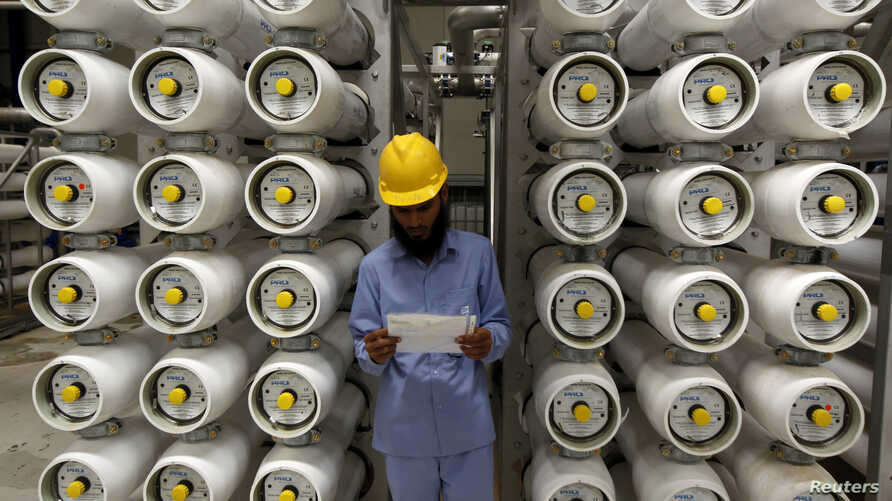 FILE - A worker stands at a desalination plant, 35 lm south of Riyadh, May 4, 2011.