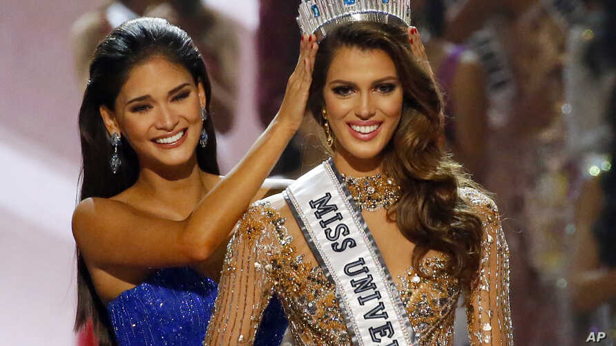 Iris Mittenaere of France is crowned the new Miss Universe 2016 by 2015 Miss Universe Pia Wurtzbach, Jan. 30, 2017.