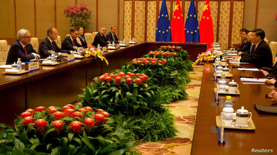 Chinese President Xi Jinping, meets with European Commission President Jean-Claude Juncker and European Council President Donald Tusk, during a meeting at the Diaoyutai State Guesthouse in Beijing, July 16, 2018.