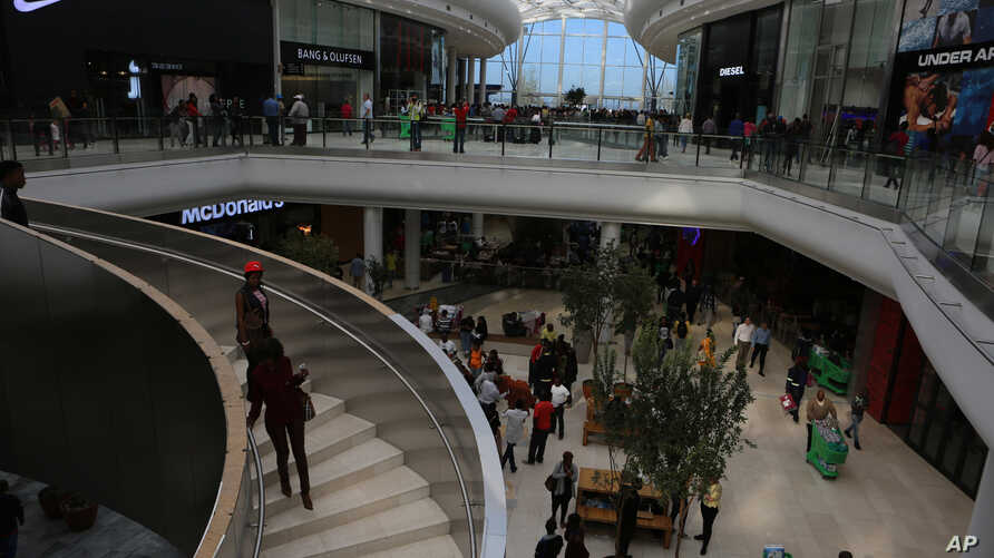 Shoppers make their way along the wide avenues inside the newly opened Mall of Africa in Midrand, South Africa, April 28, 2016.