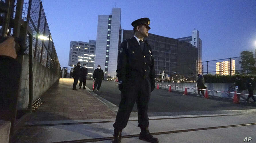 A police officer stands guard in front of Tokyo Detention Center, where former Nissan chairman Carlos Ghosn is detained, March 5, 2019, in Tokyo.