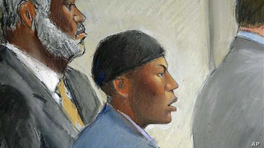 In this courtroom drawing, Umar Farouk Abdulmutallab (C) appears in U.S. District Judge Nancy Edmunds' courtroom in Detroit, Michigan, with Anthony Chambers, the lawyer who was assisting in his defense (L) and Assistant U.S. Attorney Jonathan Tukel (