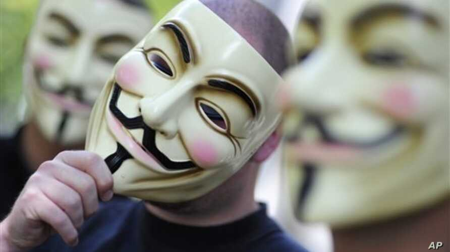 """Activists of the international network """"Anonymous"""" behind their masks posing in Berlin."""