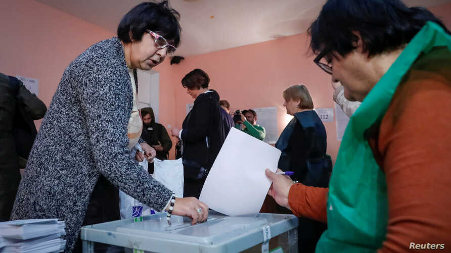 People vote at a polling station during the presidential election in Tbilisi, Georgia, Oct. 28, 2018.