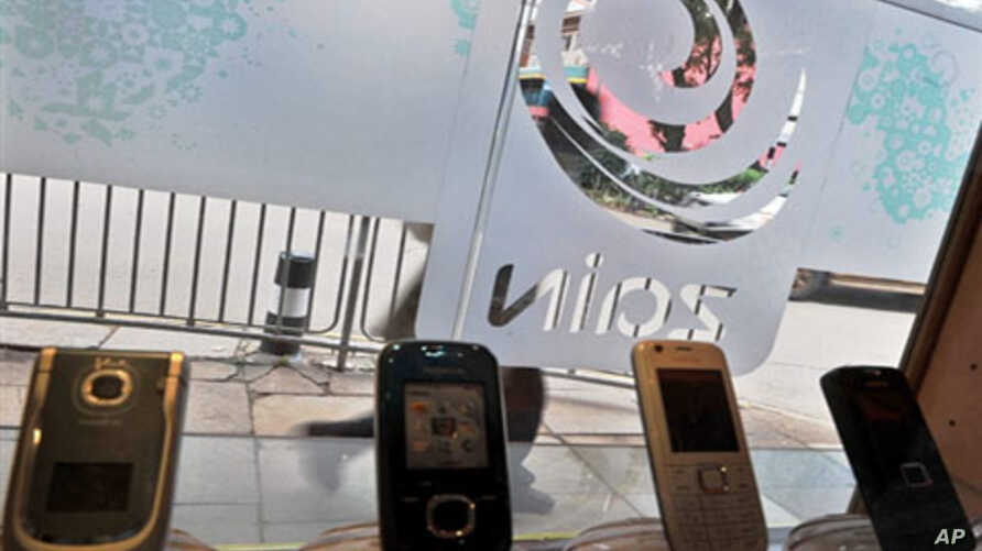 A Zain store displays mobile phones in the Kenyan capital Nairobi. Indian telecoms tycoon Sunil Bharti Mittal announced it had sealed the agreement to buy most of Zain's African assets 31 Mar 2010