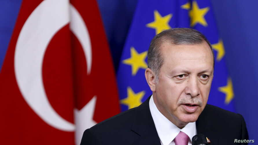 Turkey's President Tayyip Erdogan talks to the media before a meeting with European Commission President Jean-Claude Juncker (not pictured) at the EU Commission headquarters in Brussels, Belgium, Oct. 5, 2015.