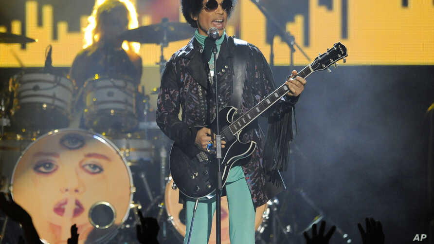 FILE -- Prince performs at the Billboard Music Awards at the MGM Grand Garden Arena in Las Vegas on May 19, 2013. More than five months after Prince's fatal drug overdose, investigators are narrowing their focus.