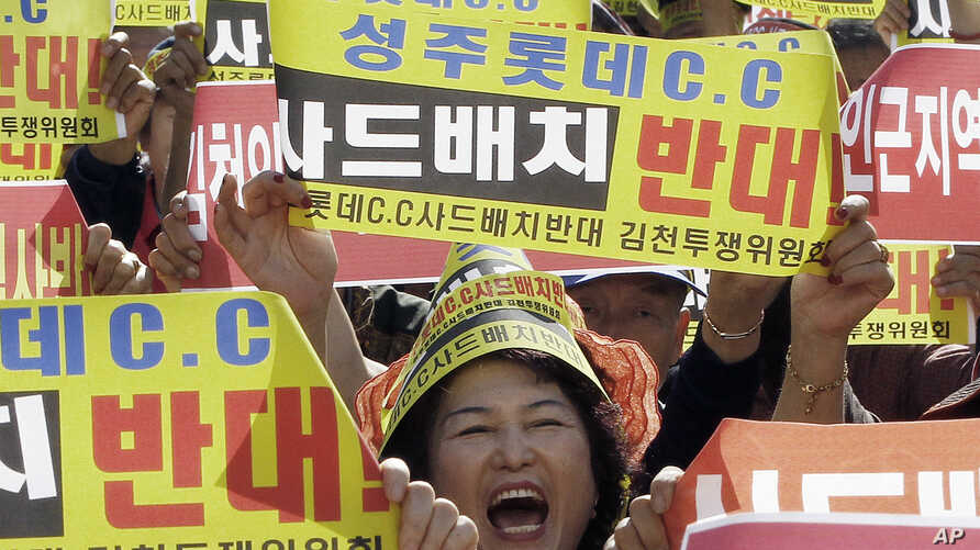A resident in a rural South Korean town shouts slogans to protest a plan to deploy an advanced U.S. missile defense system called Terminal High-Altitude Area Defense, or THAAD, in their neighborhood, in Seoul, South Korea, Oct. 5, 2016.