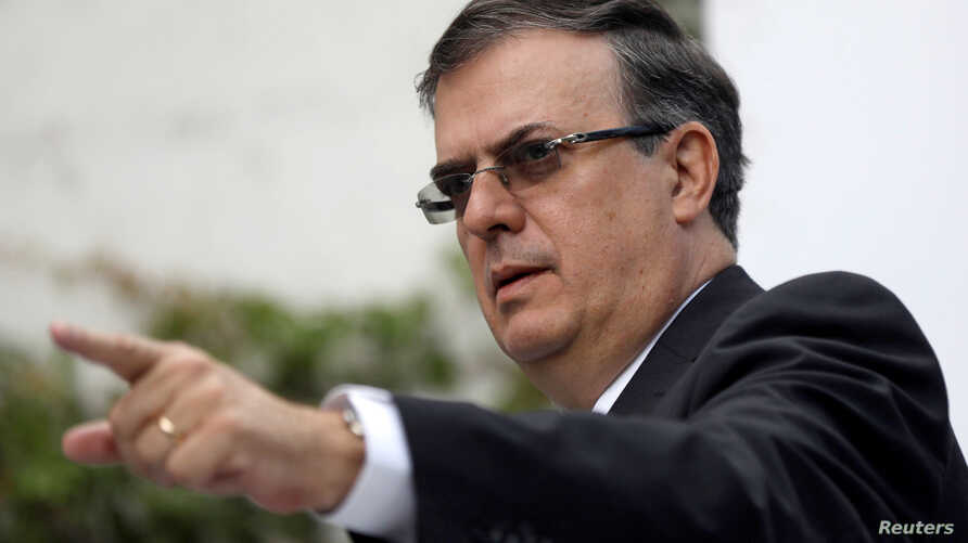 Marcelo Ebrard, picked by Mexico's President-Elect Andres Manuel Lopez Obrador as an Foreign Minister, gestures during a news conference in Mexico City, Oct. 1, 2018.
