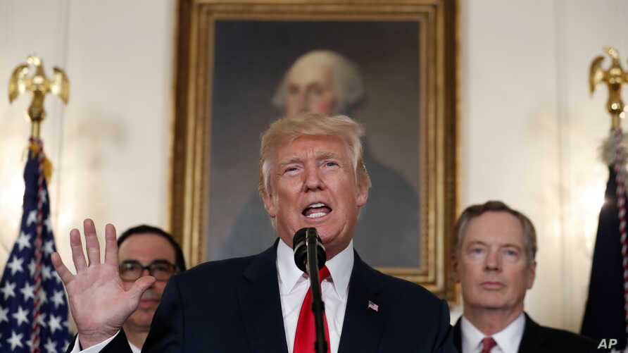President Donald Trump speaks during an event to sign a memorandum calling for a trade investigation of China, Aug. 14, 2017, in the White House. U.S. Trade Representative Robert Lighthizer is behind him to the right.