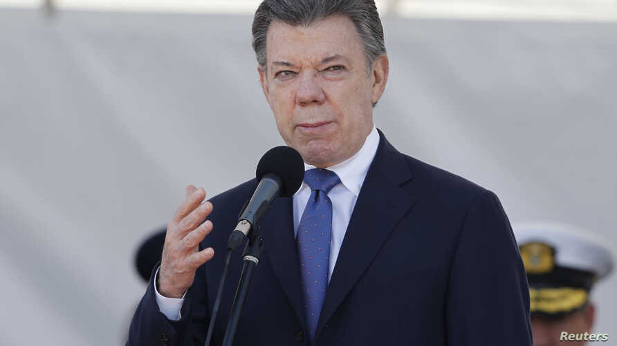 Colombian President Juan Manuel Santos gives a speech during a ceremony to mark the 94th anniversary of the Colombian Air Force at a military base in Bogota, Nov. 8, 2013