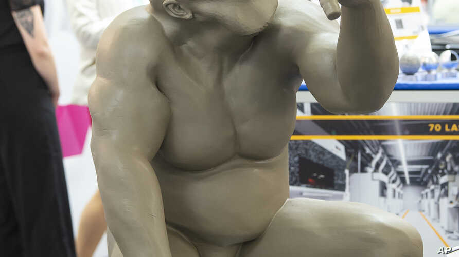 FILE - A 3D-printed model of a Neanderthal man stands at the stand of FIT AG during a media presentation at the international fairs FabCon 3.D and Rapid.Tech, Germany, June 5, 2018.