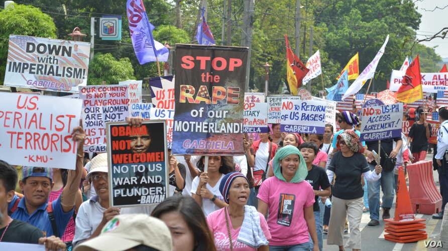 The women's advocacy group Gabriela is one of the lead organizers of anti-American military protests like this one in Manila ahead of President Barrack Obama's visit, April 23, 2014. (Simone Orendain/VOA)