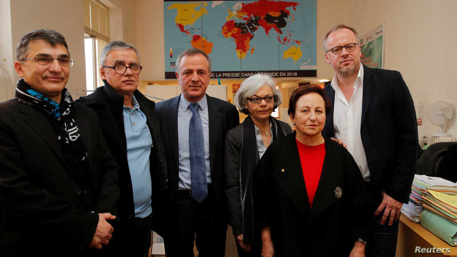Reza Moini, head of RSF's Iran/Afghanistan desk, Taghi Rahmani, Iraj Mesdaghi, Monireh Baradaran,Shirin Ebadi and Christophe Deloire, director of RSF during a news conference on Iran at the RSF offices in Paris, Feb. 7, 2019.