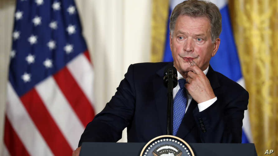 FILE - Finnish President Sauli Niinisto listens to a question during a news conference with President Donald Trump in the East Room of the White House in Washington, Aug. 28, 2017.
