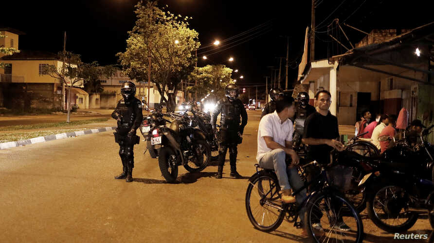 Police officers patrol a street in the working-class neighborhood of Caimbe on Boa Vista's west side where most Venezuelan immigrants live, Roraima state, Brazil November 18, 2017.