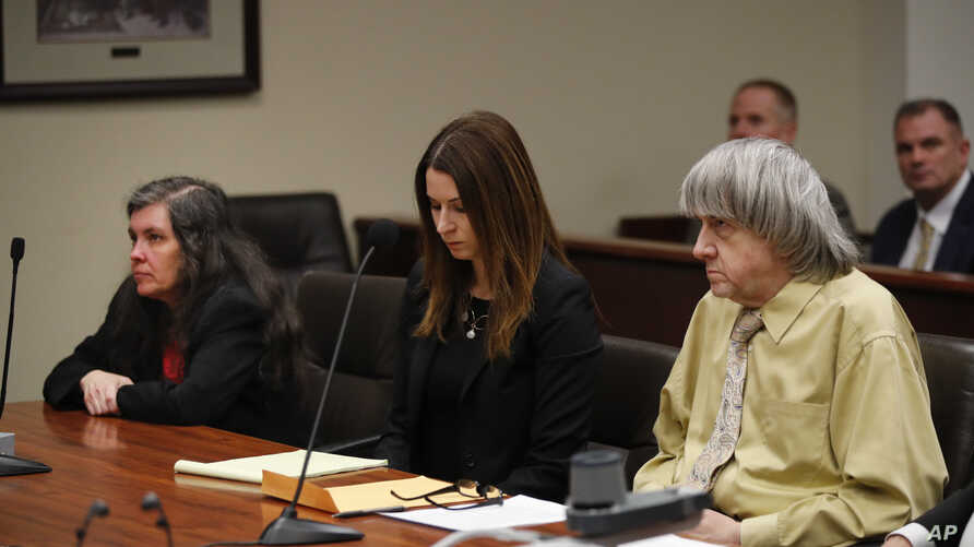 David Turpin, right, his wife, Louise, left, and attorney Allison Lowe listen to the judge during a courtroom hearing, Feb. 22, 2019, in Riverside, Calif. The California couple who shackled some of their 13 children to beds and starved them pleaded g