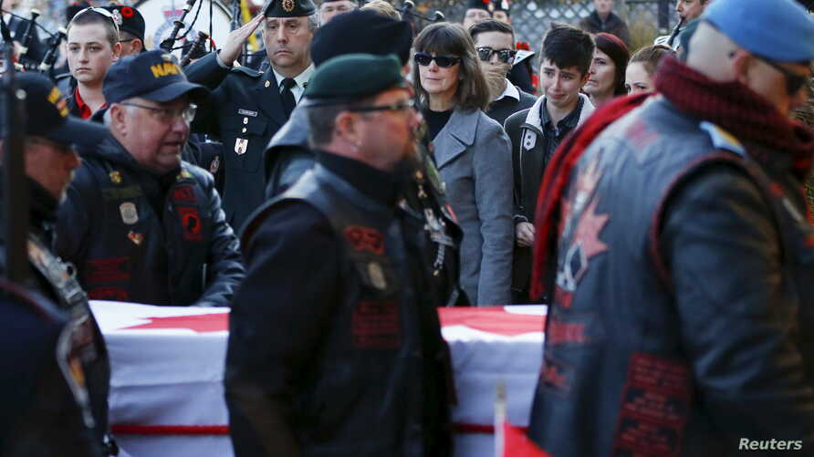 FILE - Pallbearers carry the casket of John Gallagher, a Canadian volunteer fighter and former Canadian forces member who was killed fighting alongside Kurdish forces in Syria against the Islamic State group, Ontario, Canada, Nov. 20, 2015.