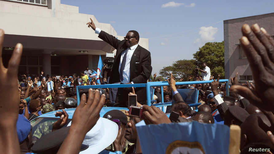 Malawi's President Peter Mutharika of the Democratic Progressive Party waves to supporters after he was sworn in in Blantyre May 31, 2014. The Malawi Electoral Commission announced Mutharika on Friday as the winner of the disputed May 20 elections wi