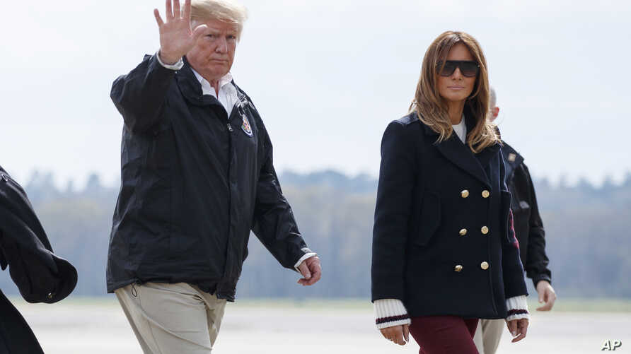 FILE - President Donald Trump and first lady Melania Trump walk from Marine One to board Air Force One at Lawson Army Airfield, Fort Benning, Ga., en route Palm Beach International Airport in West Palm Beach, Fla., March 8, 2019 photo.